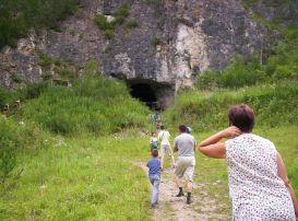 Tourists in front of the Denisova Cave, where X-woman was found