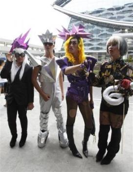 Fans of singer Lady Gaga pose in their outfits before watching the first day concert of Lady Gaga in Manila