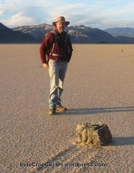 Richard Norris stands next to a Racetrack Playa rock