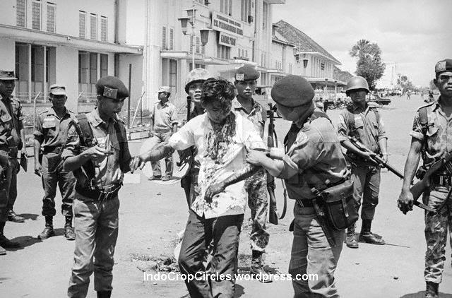 Soldiers rescuing an ethnic-Chinese youth from the mob, 1966