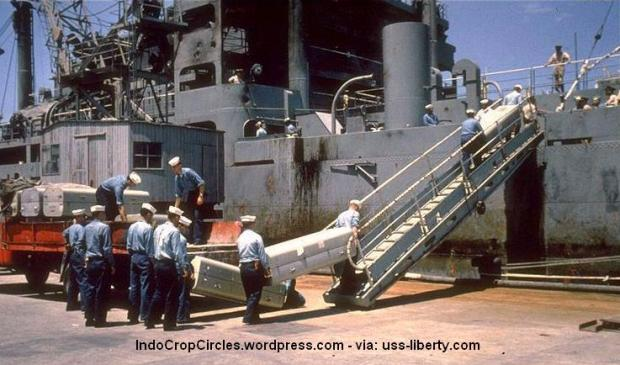 Never investigated: Some of the 34 officers and crew members of the USS Liberty, murdered in an Israeli attack in international waters on June 8, 1967, are removed from the ship in metal coffins. (USS Liberty)