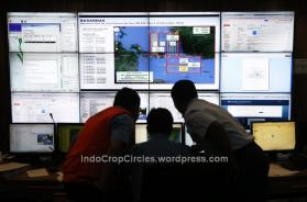 Authorities monitor progress in the search for AirAsia Flight QZ8501 in the Mission Control Center inside the National Search and Rescue Agency in Jakarta on Dec. 29, 2014