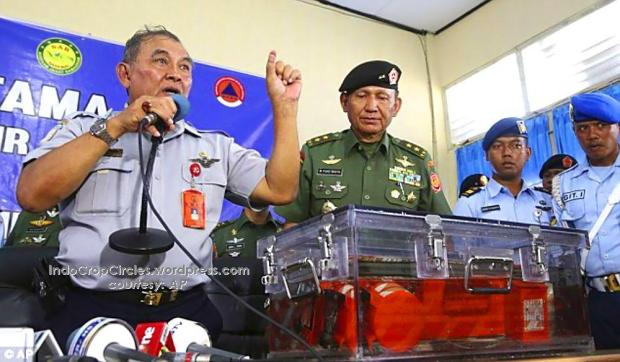 Chief of the National Transportation Safety Board Tatang Kurniadi (left) speaks to the media while showing the flight data recorder that was retrieved from the first black box. (AP).