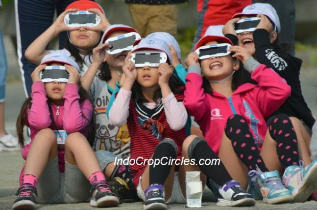 May 20, 2012 - Tokorozawa, Japan - Japanese school children use specially designed eye glasses to observe the annular solar eclipse in progress. Some 83 million people along Japan's Pacific Coasts observed the rare phenomenon, in which the moon blocks all but a ring of the suns light. In Tokyo, it was viewed for the first time in 173 years. (Credit Image: © Natsuki Sakai/AFLO/ZUMAPRESS.com) ***** Online: Report online usage by emailing the caption info to wsj@zumapress.com *****
