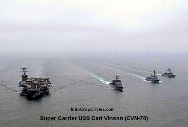 The Nimitz-class aircraft carrier USS Carl Vinson (CVN 70) performs tactical maneuvering exercises